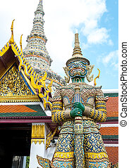 Looking up at giant statue at Grand palace, Temple of the...