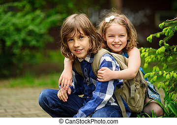 Two children of younger school age, the boy and the girl,...