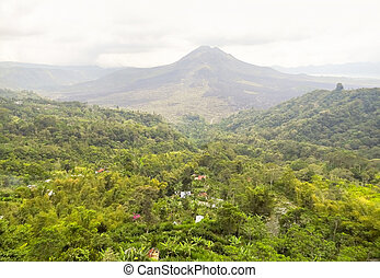 Mount Batur in Indonesia - scenery around a volcano named...
