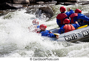 Group in out of control white water raft - Group of...