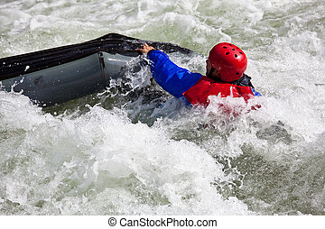White water kayaking - Canoeing in white water in rapids on...