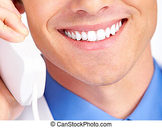 Smile - Smiling medical doctor calling by phone Over white...