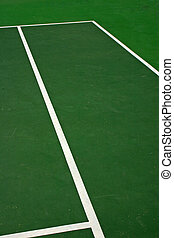 Green Tennis Court - Yellow-red balls on a green tennis...