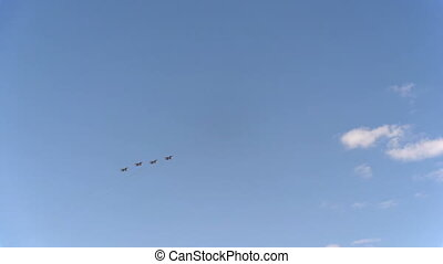 Four fighters Mig-31 fly in blue sky
