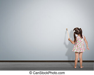 child writing with paint brush on empty wall, back view