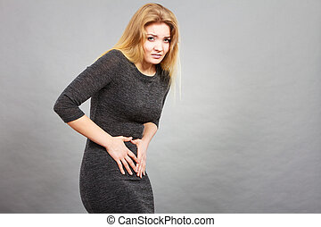 Woman having strong stomach ache. Syndroms of indigestion...