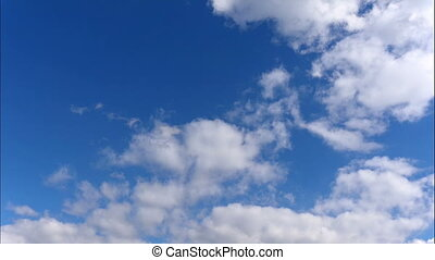 Time lapse Fluffy clouds float across the blue sky. FHD...