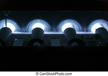 Glowing blue flame from natural gas furnace burners -...