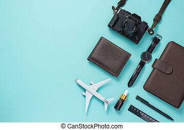Summer traveling concept. Vacation accessories on blue background.