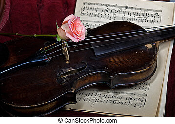 The Old Violin - Rose on an old violin with music