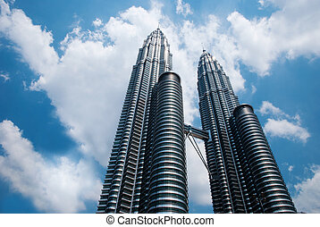 KLCC Tower with cloudy sky - KLCC Twin Tower in Kuala Lumpur