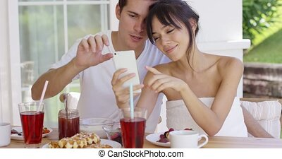 Woman taking picture of herself with husband - Smiling young...