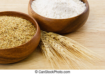 Wood bowls with flour & wheat germ - Food processed from...