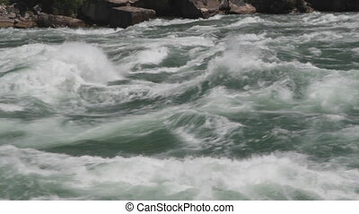 Powerful river rapids. Closeup.