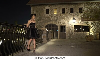 Lady walks in the ancient city at night 1