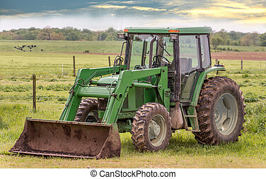 Tractor in a field on a rural Maryland farm during Spring