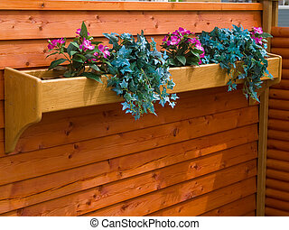 Classical planter flowerpot on a garden fence - Beautiful...