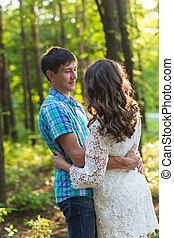 Portrait of a young romantic couple embracing each other on nature