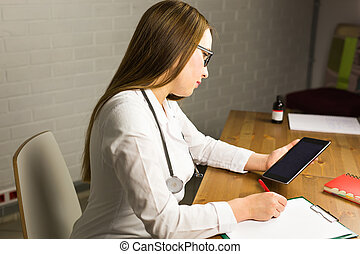 healthcare, technology and medicine concept - smiling female doctor with stethoscope and tablet pc computer.