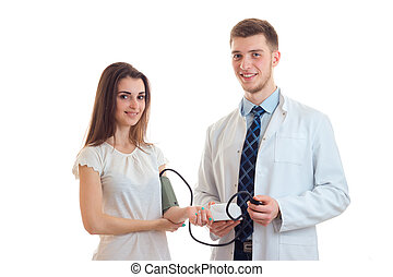 beautiful smiling girl standing next to a doctor who takes...