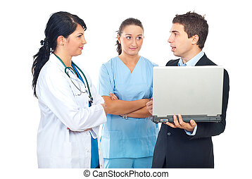 Two doctors and businessman having conversation