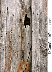 Background of Wood Board and Batten Barn Siding with a Crack...