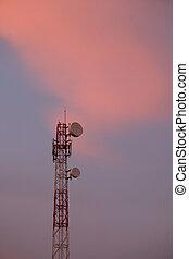 Telecommunication tower antenna at sunset