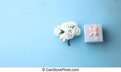 roses and gift box on a blue background - beautiful roses...