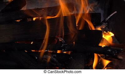 wooden firewood burns in fire - Many wooden firewood burns...