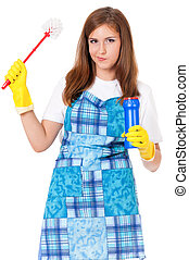 Housewife with cleaning supplies - Tired young woman holding...