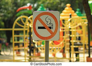 No smoking sign near children's playground in public park