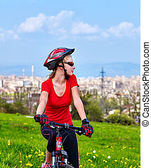 Escape urban . Bicycle girl wearing helmet rest from city...
