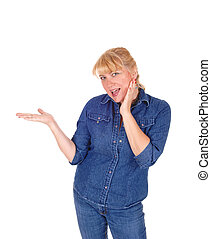 Smiling blond woman pointing. - A beautiful blond woman...