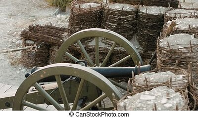 French soldier sets fire to the wick on the cannon and it...