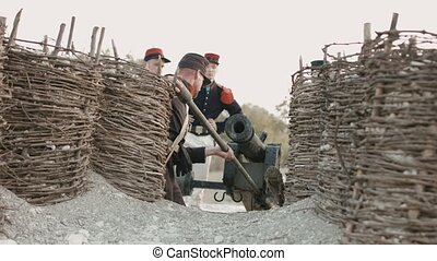 French soldiers prepare the cannon for the shot located on...
