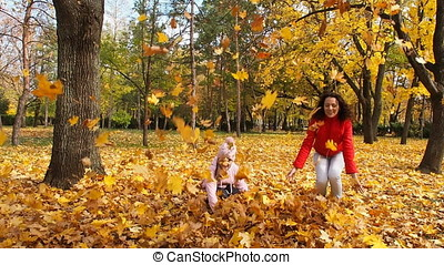 Family in the autumn park playing with leaves. Full HD
