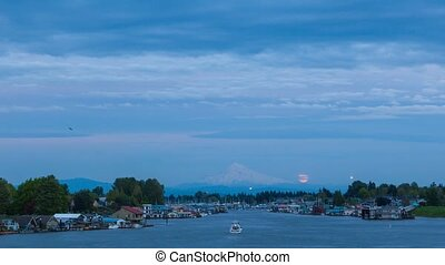 Timelapse of clouds with full moon rising over Mt. Hood...