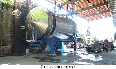 Spinning Wine Vat - A large spinning wine vat mixing a brew