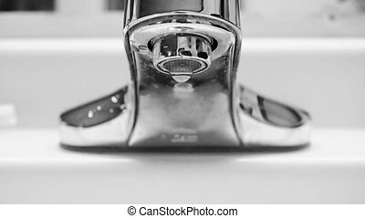 Tap Water Faucet - A closeup of a faucet dripping water...