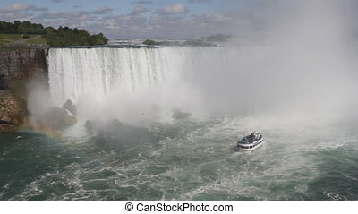 Niagara Falls and tour boat - Niagara Falls, showing the...