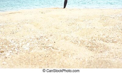 The girl is making yoga pose on beach in Vietnam. Sea or ocean woman relaxation and meditation. Healthy active lifestyle concept.