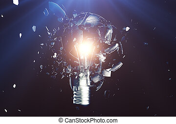 Exploding light bulb on a blue background, with concept...