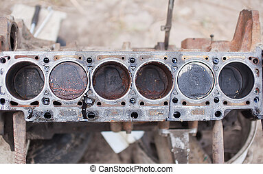 Old 6-cylinder engine with rusty pistons