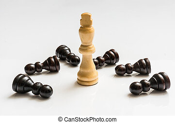 White King and many fallen pawns - chess concept