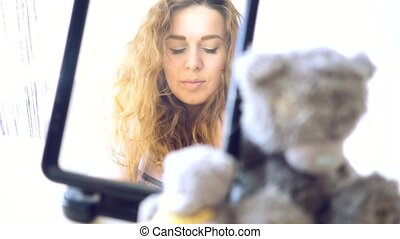 Young woman looks at herself in the mirror