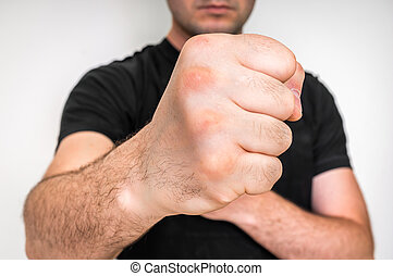 Kung fu fighter with strong hands and clenched fists -...