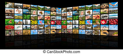 Screens forming a big multimedia broadcast video wall -...