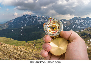 Traveler man with compass seeking a right way in the...