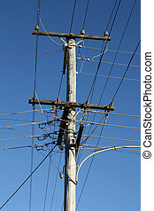 Wooden electric pylon - Old wooden electric wires pylon in...