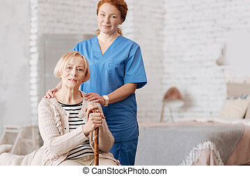 Qualified private nurse assisting elderly patient - Home...